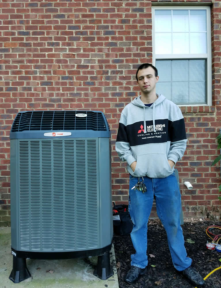 Ej Thompson Tech Standing Next To Hvac Unit